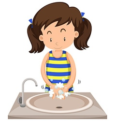 Girl washing hands in the sink vector