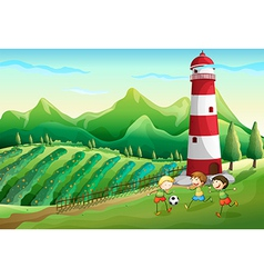 A farm with children playing near the tower vector