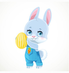 cute little bunny in denim overalls holds yellow vector image