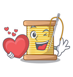 With heart thread bobbin isolated on a mascot vector