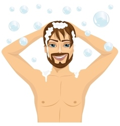 Handsome man washing hair with shampoo vector