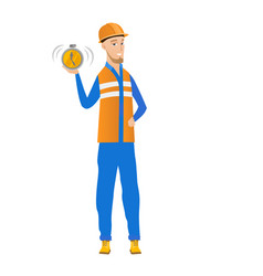 Young caucasian builder holding alarm clock vector