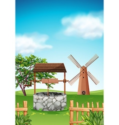 Scene with windmill and well in the farm vector image