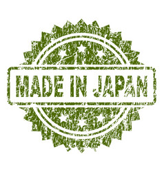 Grunge textured made in japan stamp seal vector
