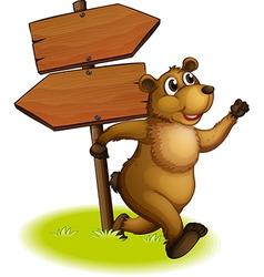 A bear running with wooden arrow board vector