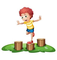 A cute young boy playing above the stumps vector image vector image