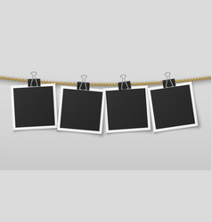 photo frame hanging on rope blank photo paper vector image