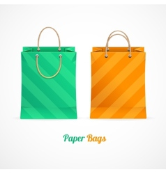 green and orange paper shopping bags vector image vector image