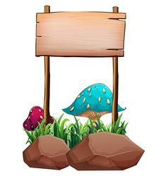 An empty wooden signboard near the big mushrooms vector image