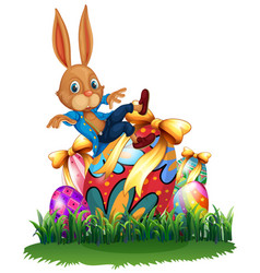 cute bunny and easter eggs in garden vector image