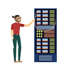 man at server rack at data center vector image