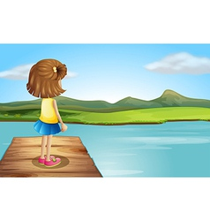 A little girl standing at the wooden port vector image