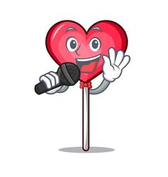 Singing heart lollipop mascot cartoon vector