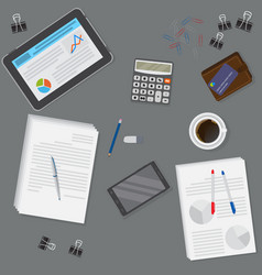 View of dark office desk including tablet vector