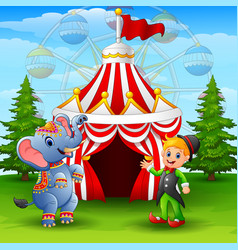 Circus elephant and green elf on the circus tent b vector