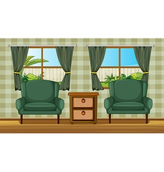 Cushion chairs and a side table vector image