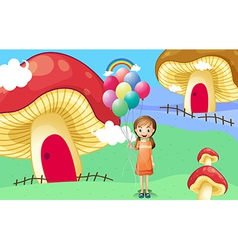 A girl with balloons near the mushroom houses vector image
