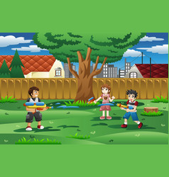 Kids playing with water gun in the backyard vector