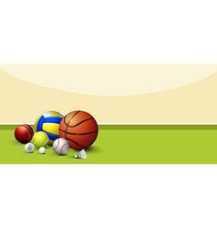 Sport equipments on green floor vector image