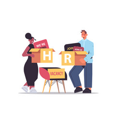 mix race hr managers couple holding cardboard vector image