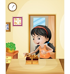 A girl with a gift at the table vector image vector image