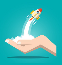 Rocket launch with human hand business startup vector