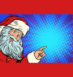 santa claus pointing to copy space vector image