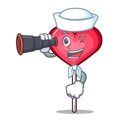 Sailor with binocular heart lollipop mascot vector