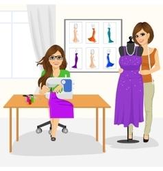 Dressmaker woman and fashion designer in studio vector
