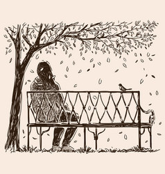 a lonely girl sits o a bench in an autumn park vector image