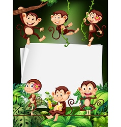 Border design with monkeys in the forest vector