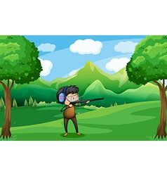 A man with a gun at the forest vector