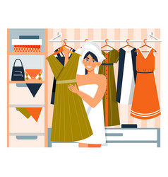 Young woman in a walk-in wardrobe with clothes vector