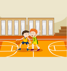 Two boys playing basketball in the gym vector