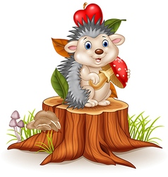 Little hedgehog holding mushroom on tree stump vector