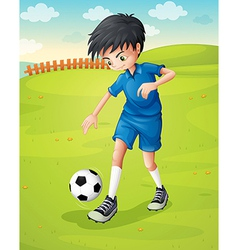 A boy with a blue uniform practicing at the vector