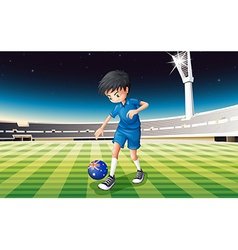 A boy at the field using the ball with the flag of vector