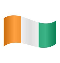 Flag of ivory coast waving on white background vector