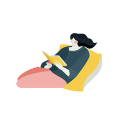 Young woman lies on yellow pillow with book rest vector