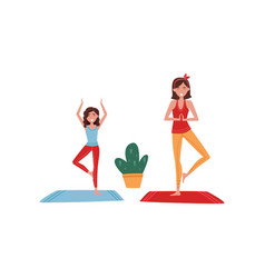young mother and her little daughter doing yoga vector image