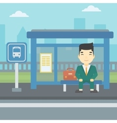Man waiting for bus at the bus stop vector