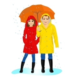 Happy couple in raincoats standing with umbrella vector