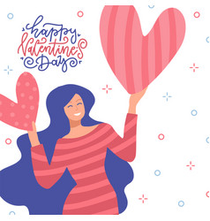 happy woman holding a two red big hearts above her vector image