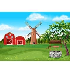 Barns and windmill in farmyard vector