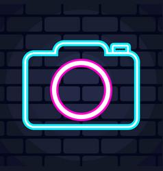 Camera neon icon on brick wall vector