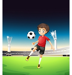 A boy playing soccer alone vector image vector image