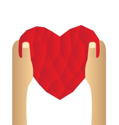 Red heart abstract as low poly on hand vector image