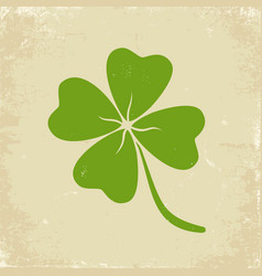 Green clover on old paper vector