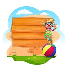 Wooden sign with clown standing on ball vector image vector image