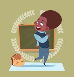 Small school boy standing over class board vector